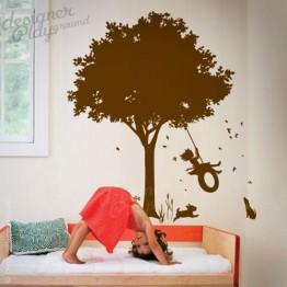 Little Girl Swinging under Tree