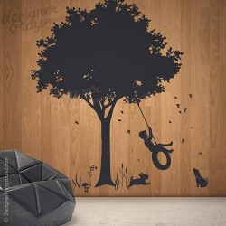 Little Boy Swinging under Tree