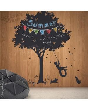 Little Boy Swinging under Tree